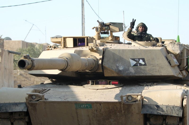 "A member of Iraq's elite counter-terrorism service flashes the ""V"" for victory sign from inside a US-made Abrams tank on December 29, 2015 on the outskirts of Ramadi, the capital of Iraq's Anbar province, about 110 kilometers west of Baghdad, after Iraqi forces recaptured it from the Islamic State (IS) jihadist group. Iraq declared the city of Ramadi liberated from the Islamic State group Monday and raised the national flag over its government complex after clinching a landmark victory against the jihadists. AFP PHOTO / AHMAD AL-RUBAYE / AFP / AHMAD AL-RUBAYE        (Photo credit should read AHMAD AL-RUBAYE/AFP/Getty Images)"