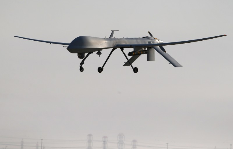 UNSPECIFIED, UNSPECIFIED - JANUARY 07:  A U.S. Air Force MQ-1B Predator unmanned aerial vehicle (UAV), carrying a Hellfire missile lands at a secret air base after flying a mission in the Persian Gulf region on January 7, 2016. The U.S. military and coalition forces use the base, located in an undisclosed location, to launch airstrikes against ISIL in Iraq and Syria, as well as to distribute cargo and transport troops supporting Operation Inherent Resolve. The Predators at the base are operated and maintained by the 46th Expeditionary Reconnaissance Squadron, currently attached to the 386th Air Expeditionary Wing.  (Photo by John Moore/Getty Images)
