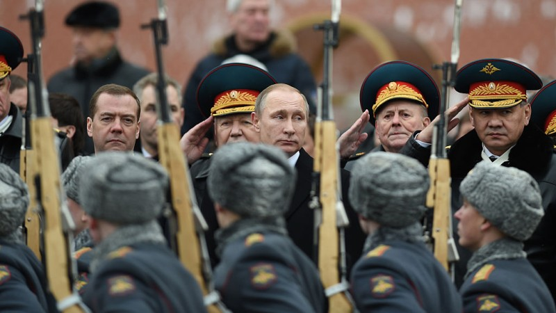 MOSCOW, Feb. 23, 2016: Russian Prime Minister Dmitry Medvedev, Russian President Vladimir Putin and Russian Defense Minister Sergei Shoigu, from left to right, view the honor guard during a wreath-laying ceremony in Moscow, Russia, on Feb. 23, 2016.  Several officials of the Russian government attended a wreath-laying ceremony at the Tomb of the Unknown Soldier with the eternal flame to mark the Defender of the Fatherland Day here on Tuesday. (Xinhua/Dai Tianfang via Getty Images)