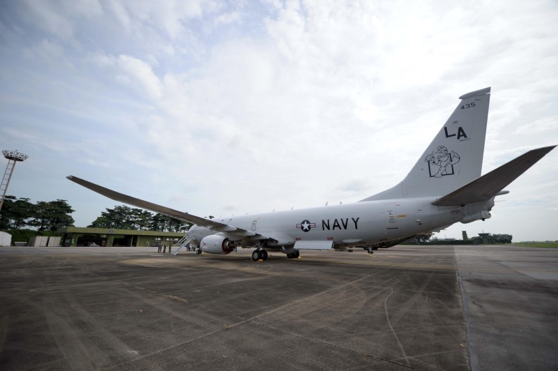 The P-8 Poseidon is parked at the Paya Lebar Airbase in Singapore on August 1, 2014.  The P-8 Poseidon maritime patrol aircraft, capable of hunting submarines, participated for the first time in the Singapore-US CARAT exercise, an annual bilateral naval drill with the city-state, one of the US closest security partners in Asia. The US Navy maintains a logistical command unit in Singapore to coordinate warship deployment and logistic in the region.   AFP PHOTO/MOHD FYROL        (Photo credit should read MOHD FYROL/AFP/Getty Images)