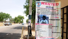 A poster displayed along the road shows photograph of Imam Abubakar Shekau, leader of the militant Islamist group Boko Haram, declared wanted by the Nigerian military with $320,471 reward for information that could lead to his capture in northeastern Nigeria town of Maiduguri May 1, 2013. Abubakar Shekau, leader of Islamist sect that has killed about 4,000 people since 2009 when it began its campaign of terror is Nigeria's most wanted man, who has been designated a terrorist by the US government. President Goodluck Jonathan has approved the constitution of a Presidential Committee to constructively engage key members of Boko Haram and define a comprehensive and workable framework for resolving the crisis of insecurity in the country. AFP PHOTO/PIUS UTOMI EKPEI        (Photo credit should read PIUS UTOMI EKPEI/AFP/Getty Images)
