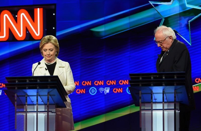 US Democratic presidential candidates Hillary Clinton (L) and Bernie Sanders arrive on stage for the CNN Democratic Presidential Debate at the Brooklyn Navy Yard on April 14, 2016, in New York. Hillary Clinton and Bernie Sanders take their increasingly acrimonious battle for the Democratic White House nomination to a debate stage in Brooklyn on Thursday ahead of the key New York primary. / AFP / Jewel SAMAD        (Photo credit should read JEWEL SAMAD/AFP/Getty Images)