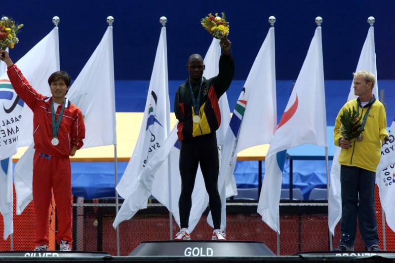 26 Oct 2000:  Elliot Mujaji of Zimbabwe (gold), Haichen Liang of China (silver) and Tim Matthews of Australia (bronze) in the Mens 100m T46 Final at the Sydney 2000 Paralympic Games at the Olympic Stadium, Homebush Bay, Sydney, Australia. X DIGITAL IMAGE. Mandatory Credit: Sean Garnsworthy/ALLSPORT