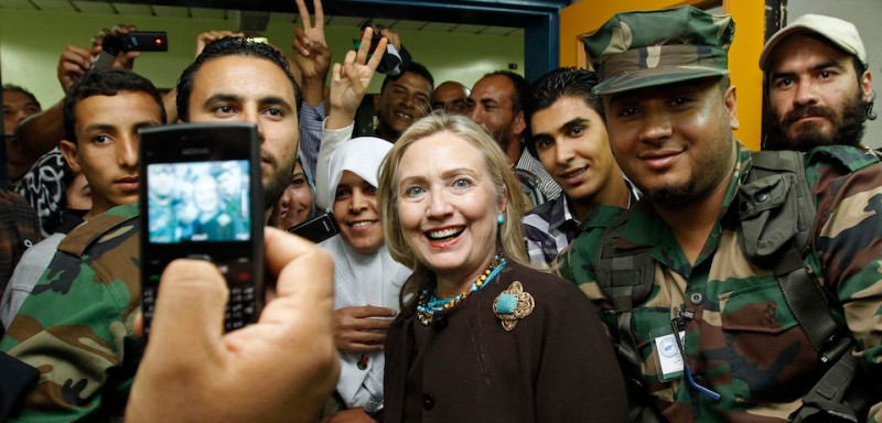 U.S. Secretary of State Hillary Clinton poses for a photo during a visit a hospital in Tripoli, the capital of Libya on October 18, 2011. AFP PHOTO/KEVIN LAMARQUE/POOL (Photo credit should read )