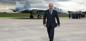 Russian Prime Minister Vladimir Putin walks near a new Russian fighter jet Sukhoi T-50, after its flight in Zhukovksy, outside Moscow on June 17, 2010. AFP PHOTO / RIA NOVOSTI / POOL / ALEXEY DRUZHININ (Photo credit should read ALEXEY DRUZHININ/AFP/Getty Images)