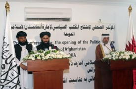 """Qatari Assistant Minister for Foreign Affairs Ali bin Fahd al-Hajri (R) and the Talibans office spokesman Mohammed Naim (C) speak during a joint press conference at the opening ceremony of the new Taliban political office in Doha on June 18, 2013. The office is intended to open dialogue with the international community and Afghan groups for a """"peaceful solution"""" in Afghanistan Naim told reporters. AFP PHOTO / FAISAL AL-TIMIMI        (Photo credit should read FAISAL AL-TIMIMI/AFP/Getty Images)"""