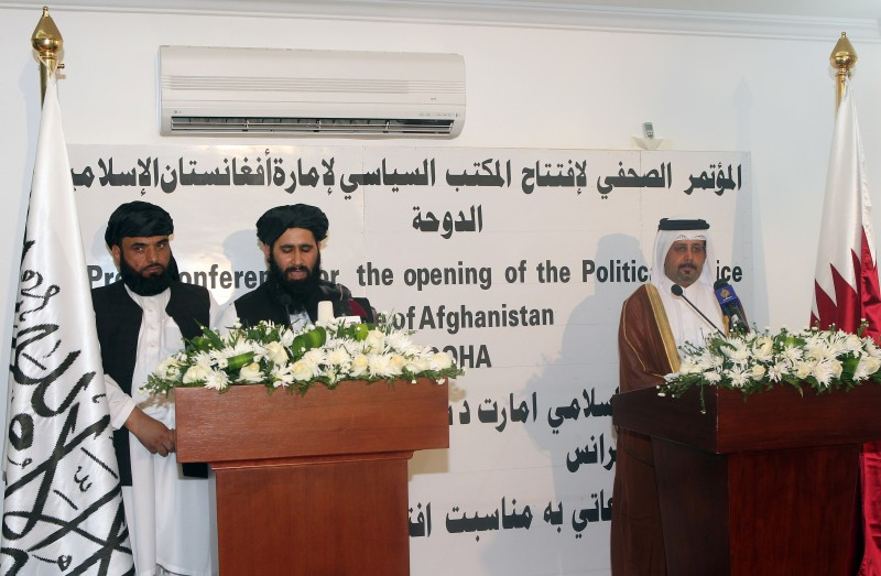 "Qatari Assistant Minister for Foreign Affairs Ali bin Fahd al-Hajri (R) and the Talibans office spokesman Mohammed Naim (C) speak during a joint press conference at the opening ceremony of the new Taliban political office in Doha on June 18, 2013. The office is intended to open dialogue with the international community and Afghan groups for a ""peaceful solution"" in Afghanistan Naim told reporters. AFP PHOTO / FAISAL AL-TIMIMI        (Photo credit should read FAISAL AL-TIMIMI/AFP/Getty Images)"