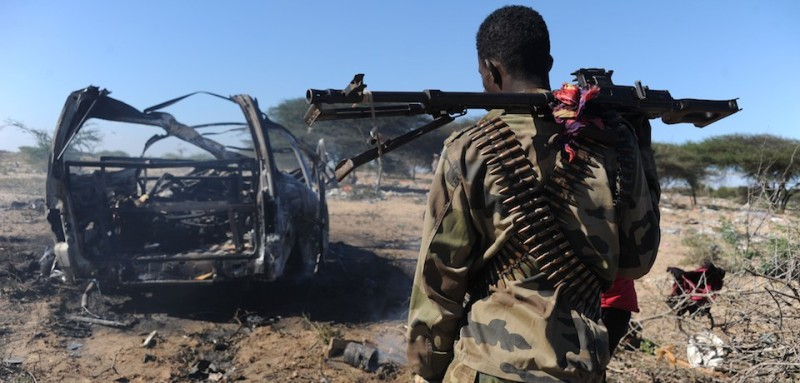 A soldiers checks the area where a suicide bomber from Somalia's Shebab insurgents killed at least 12 people and wounded 27 others, on September 8, 2014, by ramming a vehicle packed with explosives into a convoy of African Union troops in Mogadishu. The attack, the latest in a string of killings, comes exactly one week after a US airstrike killed the chief of the Al-Qaeda-linked Shebab rebels, Ahmed Abdi Godane, prompting threats of retaliation from the extremists.    AFP PHOTO MOHAMED ABDIWAHAB        (Photo credit should read Mohamed Abdiwahab/AFP/Getty Images)