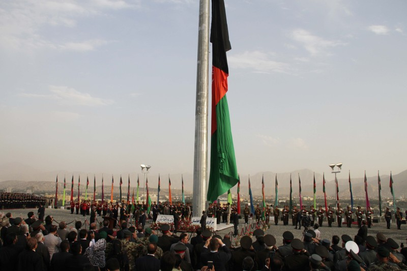 KABUL, AFGHANISTAN - SEPTEMBER 10: The largest Afghan flag is seen during an inauguration ceremony of Wazir Akbar Khan hill in Kabul on September 10, 2014. Afghan President Hamid Karzai and Indian Foreign Minister Sushma Swaraj raised the largest Afghan flag in Kabul as Sushma Swaraj announced a one million dollar donation to build a park on Wazir Akbar Khan hill.  (Photo by Haroon Sabawoon/Anadolu Agency/Getty Images)