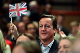 British Prime Minister David Cameron listens to a final speech by former Foreign Secretary William Hague before he resigns as a Member of Parliament on day one of the Conservative Party conference in Birmingham in central England on September 28, 2014.  British Prime Minister David Cameron is bidding to rally his Conservatives for victory at next year's general election at their annual conference, with the party reeling from a defection and a sex scandal.AFP PHOTO/CARL COURT        (Photo credit should read CARL COURT/AFP/Getty Images)