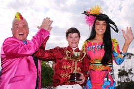 GEELONG, AUSTRALIA - OCTOBER 22:  City of Greater Geelong Mayor, Cr Darryn Lyons (L) and his fiancee Elissa Friday pose with Craig Williams (C) after he won on Caravan Rolls On in race 7 the Sportingbet Powered By William Hill Geelong Cup, the fifth time he has won the race, during Geelong Cup Day at  on October 22, 2014 in Geelong, Australia.  (Photo by Michael Dodge/Getty Images)
