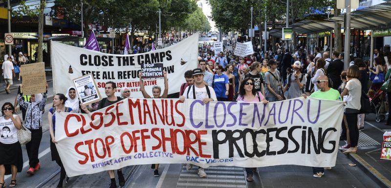 MELBOURNE, AUSTRALIA - JANUARY 22:  A group of people hold placards during a protest in Melbourne, Australia on January 22, 2015 to support the Manus Island asylum seekers and call for an end to offshore processing. (Photo by Recep Sakar/Anadolu Agency/Getty Images)