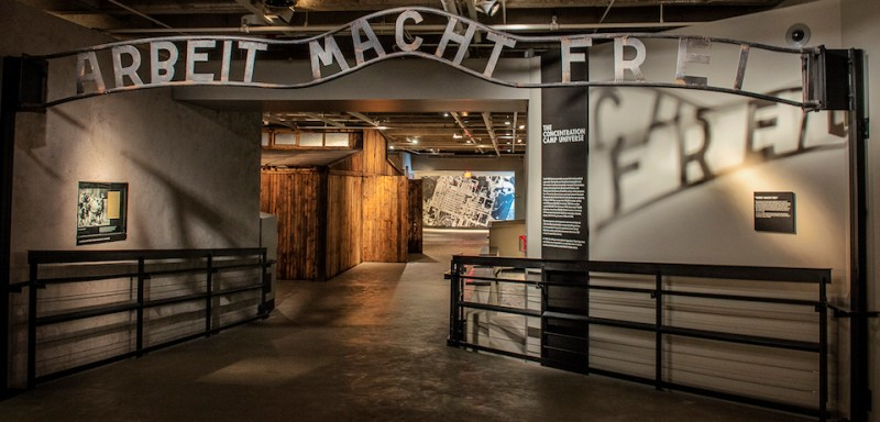 WASHINGTON, DC - APRIL 17: Visitors to the United States Holocaust Museum, which is about to celebrate its' 20th anniversary, pass beneath a cast taken from the original entrance to the Auschwitz death camp, inscribed with the phrase Arbeit Macht Frei (Work Makes One Free), on April, 17, 2013 in Washington, DC. (Photo by )