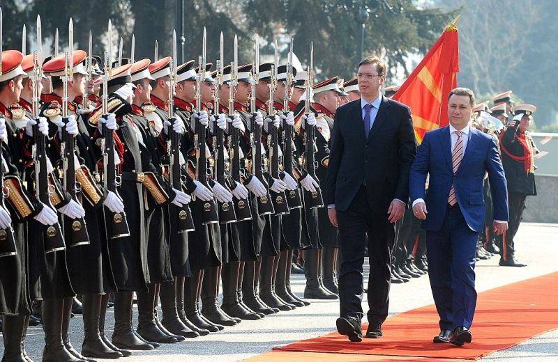 Serbian Prime Minister Alaksandar Vucic (L) and his Macedonian counterpart Nikola Gruevski (R) inspect the honor guard in front of the government building in Skopje on February 16, 2015, at the start of Vucic's official visit to Macedonia where he is to take part in a meeting gathering both governments. AFP  PHOTOS / ROBERT ATANASOVSKI        (Photo credit should read ROBERT ATANASOVSKI/AFP/Getty Images)