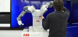 Worker prepares the collaborative dual-arm robot YuMi at the Swiss automation group ABB booth at the Hannover Messe industrial trade fair in Hanover, central Germany on April 13, 2015. India is the partner country of this year's trade fair running until April 17, 2015. AFP PHOTO / TOBIAS SCHWARZ        (Photo credit should read TOBIAS SCHWARZ/AFP/Getty Images)
