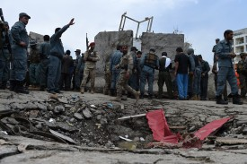 Afghan security personnel stand at the scene of a suicide attack by Taliban militants on the Afghan parliament building in Kabul on June 22, 2015.Taliban militants attacked the Afghan parliament on June 22, with gunfire and explosions rocking the building, sending lawmakers running for cover in chaotic scenes relayed live on television.The insurgents tried to storm the complex after triggering a car bomb but were repelled and have taken position in a partially-constructed building nearby, officials said about the ongoing attack. All MPs were safely evacuated after the attack, which came as the Afghan president's nominee for the crucial post of defence minister was to be introduced in parliament. AFP PHOTO / Wakil Kohsar        (Photo credit should read WAKIL KOHSAR/AFP/Getty Images)