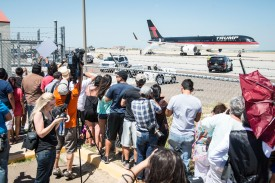 LAREDO, TEXAS - JULY 23: Citizens watch as Republican Presidential candidate and business mogul Donald Trump leaves in his plane after his trip to the border on July 23, 2015 in Laredo, Texas. Trump's recent comments, calling some immigrants from Mexico as drug traffickers and rapists, have stirred up reactions on both sides of the aisle. Although fellow Republican presidential candidate Rick Perry has denounced Trump's comments and his campaign in general, U.S. Senator from Texas Ted-Cruz has so far refused to bash his fellow Republican nominee. (Photo by Matthew Busch/Getty Images)