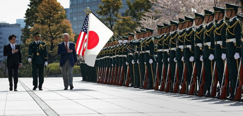 "Accompanied by Japanese Defense Minister Itsunori Onodera (L), US Secretary of Defense Chuck Hagel (3rd L) reviews an honour guard at the Japanese Ministry of Defense headquarters in Tokyo on April 6, 2014.   The US plans to send two more missile defence warships to Japan to counter the threat posed by North Korea's ""provocative"" actions, Pentagon chief Chuck Hagel said on April 6.    AFP PHOTO / POOL / ALEX WONG        (Photo credit should read ALEX WONG/AFP/Getty Images)"