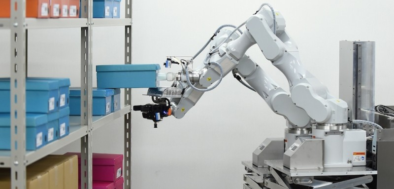 A prototype robot with two arms, which was developed by Japan's comprehensive electrical machinery manufacturer Hitachi for distribution warehouses, demonstrates its abilities during a demonstration for the media at a warehouse in Noda, in suburban Tokyo, on August 25, 2015. The robot can move to a location, take items off shelves and put them into boxes automatically, in place of employees.    AFP PHOTO / Toru YAMANAKA        (Photo credit should read TORU YAMANAKA/AFP/Getty Images)
