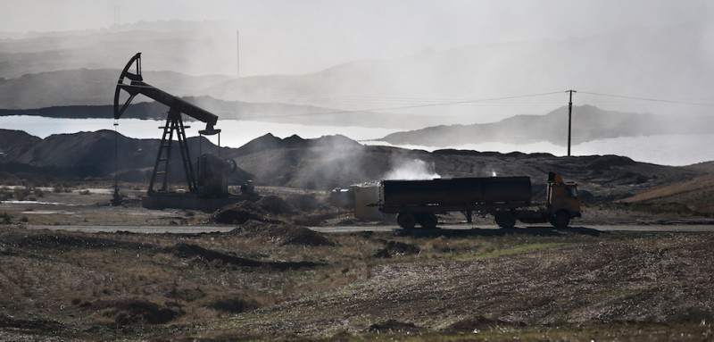 DEREK, SYRIA - NOVEMBER 14:  A truck prepares to dump the dregs of oil refined into diesel fuel on November 14, 2015 near Derek, in Rojava, Syria. The predominantly Kurdish autonomous Rojava region of northern Syria had previously been supplied with pretroleum from refineries in areas now under Daesh control, so Rojavans have begun crudely processing their own reserves into diesel for domestic fuel and heating needs. The Islamic State, however, continues to pump and export millions of barrels of oil, generating vast revenues for its regional war machinery and international terrorist activities.  (Photo by )