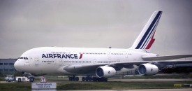 PARIS, FRANCE - NOVEMBER 10, 2015: An Air France Airbus A380 aircraft is towed toward the runway at Charles de Gaulle Airport in Paris, France. The A380 is the world's largest commercial passenger aircraft. (Photo by