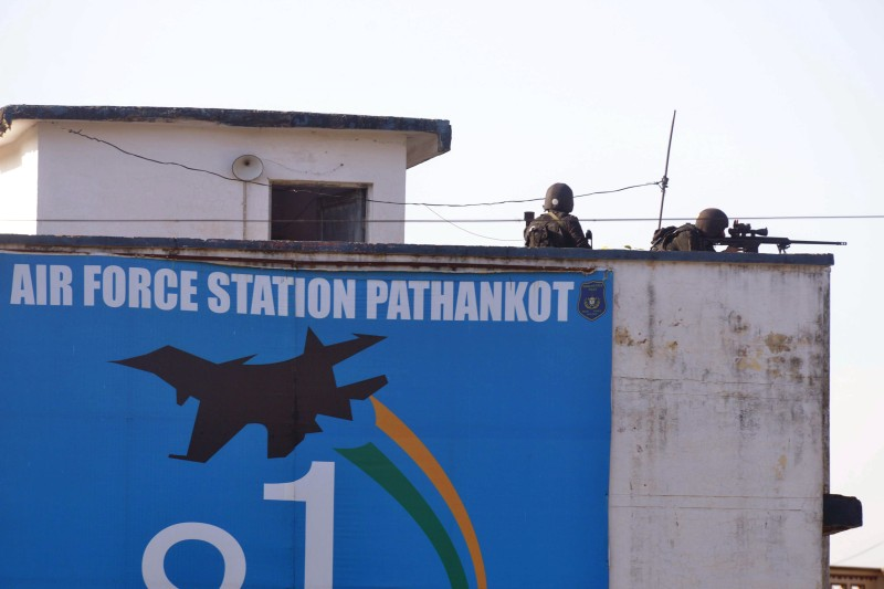 Indian commandos overlook the air force base in Pathankot on January 5, 2016. Indian Prime Minister Narendra Modi urged his Pakistani counterpart on January 5 to take 'firm and immediate action' against those behind an attack on an Indian air force base that left seven soldiers dead. AFP PHOTO/NARINDER NANU  / AFP / NARINDER NANU        (Photo credit should read NARINDER NANU/AFP/Getty Images)