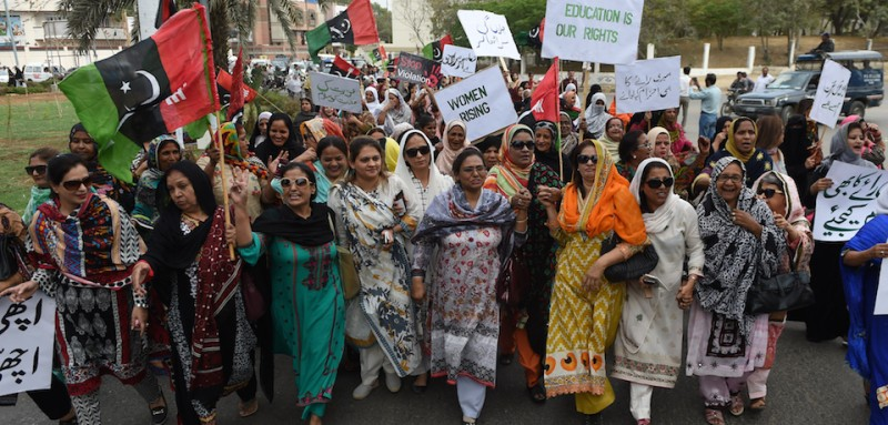 Activists of The Pakistan People's Party (PPP) hold placards as they march during a rally to mark International Women's Day in Karachi on March 8, 2016.  Women in conservative Pakistan have fought for their rights for decades, in a country where so-called honour killings and acid attacks remain commonplace. / AFP / ASIF HASSAN        (Photo credit should read ASIF HASSAN/AFP/Getty Images)
