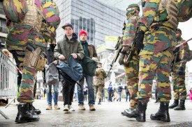 Soldiers control passers by in Brussels, on March 23 2016, one day after the attacks on Brussels airport and at a metro station.  About 20 people were killed on the metro and 14 at the airport in the rush-hour assaults, which came just days after the arrest in Brussels of the main fugitive suspect in November's gun and bomb rampage in Paris.  / AFP / BELGA / HATIM KAGHAT / Belgium OUT        (Photo credit should read HATIM KAGHAT/AFP/Getty Images)