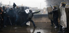 TOPSHOT - French riot police confront protesters during a demonstration against labour law reforms in the French capital Paris on March 31, 2016. France faced fresh protests over labour reforms  just a day after the beleaguered government of President Francois Hollande was forced into an embarrassing U-turn over constitutional changes.  / AFP / THOMAS SAMSON        (Photo credit should read THOMAS SAMSON/AFP/Getty Images)