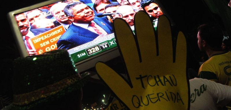 Supporters of the impeachment of Brazilian President Dilma Rousseff follow on big screens in Rio de Janeiro, Brazil, as lawmakers get close to be votes needed to authorize her impeachment to go ahead, on April 17, 2016. Brazilian lawmakers on Sunday reached the two thirds majority necessary to authorize impeachment proceedings against President Dilma Rousseff. The lower house vote sends Rousseff's case to the Senate, which can vote to open a trial. A two thirds majority in the upper house would eject her from office. Rousseff, whose approval rating has plunged to a dismal 10 percent, faces charges of embellishing public accounts to mask the budget deficit during her 2014 reelection.  / AFP / TASSO MARCELO        (Photo credit should read TASSO MARCELO/AFP/Getty Images)