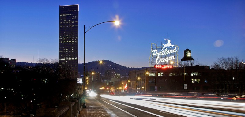 PORTLAND, OR - JANUARY 20, 2013 - Vehicle lights create light streaks over the Burnside Bridge with Old Town Portland Oregon sign on the back at dusk, January 20, 2013.;  (Photo by )