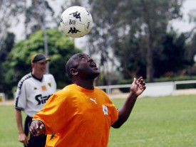 Abidjan, IVORY COAST: Burundian President Pierre Nkurunziza heads the ball as he attends a students training sessions at the ASEC Mimosas Academy in Abidjan 226 February 2007. Nkurunziza arrived in the Ivocy Coast the previous day on a three-day official visit.     AFP PHOTO / KAMBOU SIA (Photo credit should read KAMBOU SIA/AFP/Getty Images)