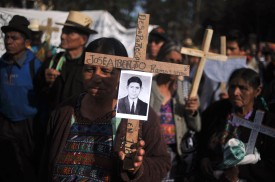A relative of a victim of Guatemala�s civil war (1960-1996) takes part in a march in Guatemala City on February 25, 2009 on the 10th anniversary of the publication of the Truth Commission's report that signaled that more than 200,000 people died or disappeared during the country's 36-year civil war and held Guatemala�s Army risponsible of 93 percent of the crimes. Guatemala�s President Alvaro Colom informed today that the Army handed over to justice the counterinsurgency plan's files between 1978 and 1983, as the human rights organizations demanded. AFP PHOTO/Eitan Abramovich (Photo credit should read EITAN ABRAMOVICH/AFP/Getty Images)