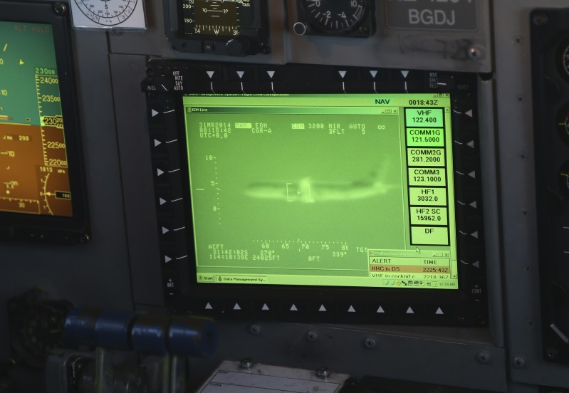 """An image of a US P8 Poseidon plane can be seen on a monitor in the cockpit of a Royal New Zealand Air Force P3 Orion while flying to the search zone to help find missing Malaysia Airlines flight MH370, over the Indian Ocean on March 31, 2014.  No time limit will be imposed on the search for MH370 because the world deserves to know what happened, Australian Prime MinisterTony Abbott said, as a ship equipped to locate the plane's """"black box"""" prepared to set sail.    AFP PHOTO / POOL / Rob GRIFFITH        (Photo credit should read ROB GRIFFITH/AFP/Getty Images)"""