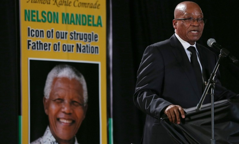 PRETORIA, SOUTH AFRICA - DECEMBER 14:  South African president Jacob Zuma speaks during an African National Congress (ANC) led alliance send off ceremony at Waterkloof military airbase on December 14, 2013 in Pretoria, South Africa. The ANC held an official send off ceremony as the body of former South African President prepares to make one final journey to his hometown of Qunu for burial. Mr. Mandela passed away on the evening of December 5, 2013 at his home in Houghton at the age of 95. Mandela became South Africa's first black president in 1994 after spending 27 years in jail for his activism against apartheid in a racially-divided South Africa.  (Photo by Justin Sullivan/Getty Images)