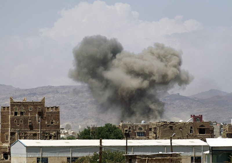 Smoke billows from buildings after reported air strikes by the Saudi-led coalition on arms warehouses at Al-Dailami air base, on September 29, 2015, north of the capital Sanaa.  AFP PHOTO / MOHAMMED HUWAIS        (Photo credit should read MOHAMMED HUWAIS/AFP/Getty Images)