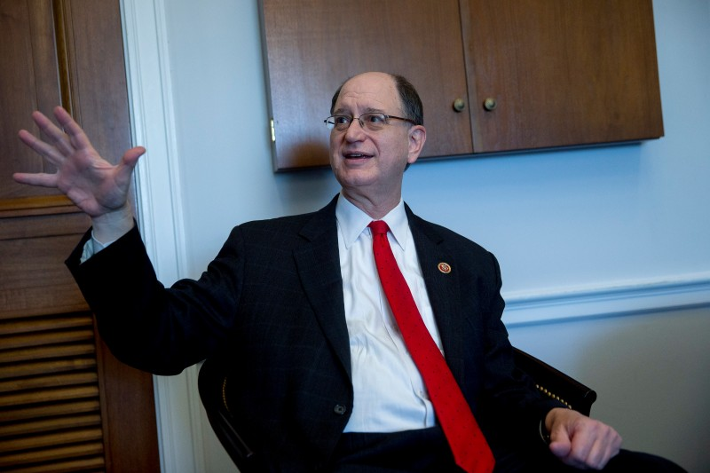 Representative Brad Sherman, a Democrat from California, talks to his communications director at his office on Capitol Hill in Washington, D.C., U.S., on Wednesday, Nov. 4, 2015. Janet Yellen can stay on GodÕs path by waiting until springtime to raise interest rates, Congressman Sherman told the Federal Reserve chair during a House Financial Services Committee hearing. Photographer: Andrew Harrer/Bloomberg via Getty Images