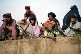 In this photograph taken on November 3, 2015, Afghan Taliban fighters listen to Mullah Mohammad Rasool Akhund (unseen), the newly appointed leader of a breakaway faction of the Taliban, at Bakwah in the western province of Farah.  A breakaway faction of the Taliban has appointed its own leader in the first formal split in the Afghan militant movement under new head Mullah Mansour, posing a fresh hurdle to potential peace talks. Mullah Rasool was named the leader of the faction in a mass gathering of dissident fighters this week in the remote southwestern province of Farah, according to an AFP reporter who attended the meeting. AFP PHOTO / Javed Tanveer        (Photo credit should read JAVED TANVEER/AFP/Getty Images)