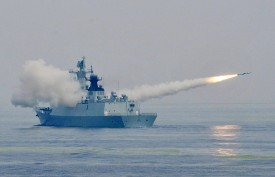 QINGDAO, CHINA - JULY 02:  (CHINA OUT) A frigate fires a missile during live-fire drill on Yellow Sea on July 2, 2015 in Qingdao, Shandong Province of China. Naval vessels and soldiers mainly from China people's Liberation Army Navy North Sea Fleet and part of soldiers of China people's Liberation Army Navy East Sea Fleet, the Second Artillery Force of the PLA, Chinese PLA Shenyang Military Region and Chinese PLA Jinan Military Region attended the live-fire drill on Yellow Sea on Thursday.  (Photo by VCG/VCG via Getty Images)