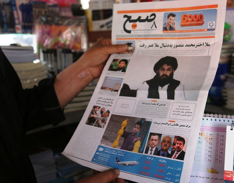 KABUL, May 23, 2016:  An Afghan man reads the news of Taliban leader's death on a local newspaper in Kabul, capital of Afghanistan, May 23, 2016. U.S. President Barack Obama confirmed on Monday that Taliban leader Mullah Akhtar Mansoor was killed in a U.S. airstrike. (Xinhua/Rahmat Alizadah via Getty Images)