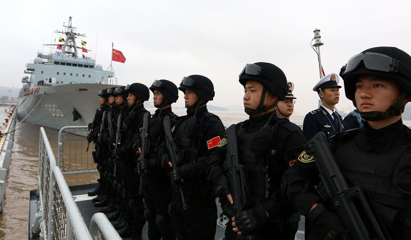 ZHOUSHAN, CHINA - APRIL 03:  (CHINA OUT) Soldiers of Chinese navy stand in line on the ship before they go to the Somalia Waters on April 3, 2015 in Zhoushan, China. The 20th Chinese Navy convoy fleet, made up of three ships, is scheduled to set sail for the Gulf of Aden near Somalia to rendezvous with the current anti-piracy fleet today.  (Photo by VCG/VCG via Getty Images)
