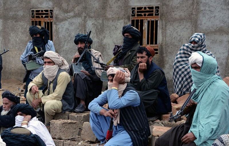 In this photograph taken on November 3, 2015, Afghan Taliban fighters look on as they listen to Mullah Mohammad Rasool Akhund (unseen), the newly appointed leader of a breakaway faction of the Taliban, at Bakwah in the western province of Farah.  A breakaway faction of the Taliban has appointed its own leader in the first formal split in the Afghan militant movement under new head Mullah Mansour, posing a fresh hurdle to potential peace talks. Mullah Rasool was named the leader of the faction in a mass gathering of dissident fighters this week in the remote southwestern province of Farah, according to an AFP reporter who attended the meeting. AFP PHOTO / Javed Tanveer        (Photo credit should read JAVED TANVEER/AFP/Getty Images)