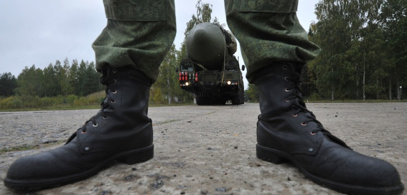 Seen through the legs of a Russian soldier a RS-24 Yars thermonuclear intercontinental ballistic missile launcher rolls at a strategic missile forces base near the town of Teykovo, some 200 km northeast of Moscow,  on September 22, 2011, with the boots. Russian strategic missile forces started to replace the mobile version of the Topol-M intercontinental ballistic missiles with an advanced Yars model in 2009, the Russian media reported. AFP PHOTO / ANDREY SMIRNOV (Photo credit should read ANDREY SMIRNOV/AFP/Getty Images)