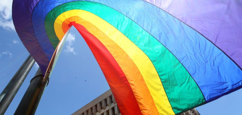 BOSTON - JUNE 6: The Gay Pride Flag swirls in the wind before being hoisted atop the flagpole at Boston City Hall during the 20th annual flag-raising ceremony to open the citys Pride Week gay rights events scheduled through Sunday, June 15. (Photo by Joanne Rathe/The Boston Globe via Getty Images)