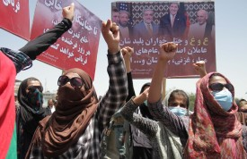 AFGHANISTAN, KABUL- JULY 06 :  Afghan women hold posters of 27 year-old Farkhunda who was beaten to death by a mob after being falsely accused of burning a Quran, during a protest held by the Solidarity Party of Afghanistan at the site of the attack in Kabul, Monday, July 6, 2015. (Photo by Haroon Sabawoon/Anadolu Agency/Getty Images)