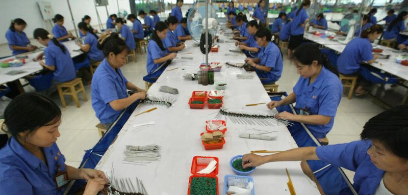 GUANGAN, CHINA:  Workers assemble goods at a Hong Kong-China joint-venture factory manufacturing wigs and other hair products for export to Africa, Europe and the Americas, as well as the domestic market, 22 August 2004 in Guangan, in southwest China's Sichuan province. China is facing increasing pressure to create employment at a time when jobs are being wiped out at an unprecedented rate as state enterprises downsize and agriculture offers too few opportunities for work. AFP PHOTO/Frederic J. BROWN  (Photo credit should read FREDERIC J. BROWN/AFP/Getty Images)