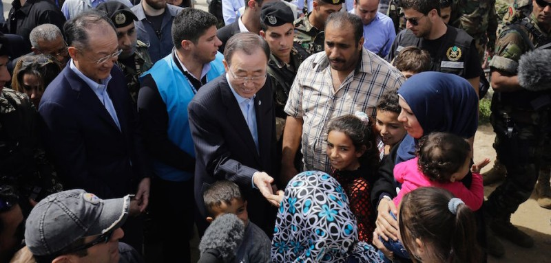 UN Secretary General Ban Ki-moon (C) meets Syrian refugees during his visit in Hay al-Tanak an impoverished district that was turned into an informal Syrian refugee camp in the northern Lebanese city of Tripoli on March 25, 2016 .  / AFP / Ibrahim Chalhoub        (Photo credit should read )