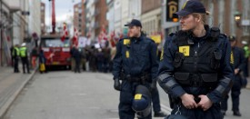 "The anti-muslim Danish Pegida clone ""For Frihed"" (For Freedom) marched in the centre of Copenhagen, Denmark on 9 April 2016 protected by upwards a hundred police, while some 60 anti-Pegida demonstrators attempted to disrupt the march. The march took place on the date, when Denmark was occupied by German forces in 1940.  In photo: Policemen protection the marchers. Denmark 9 April 2016 (Photo by )"