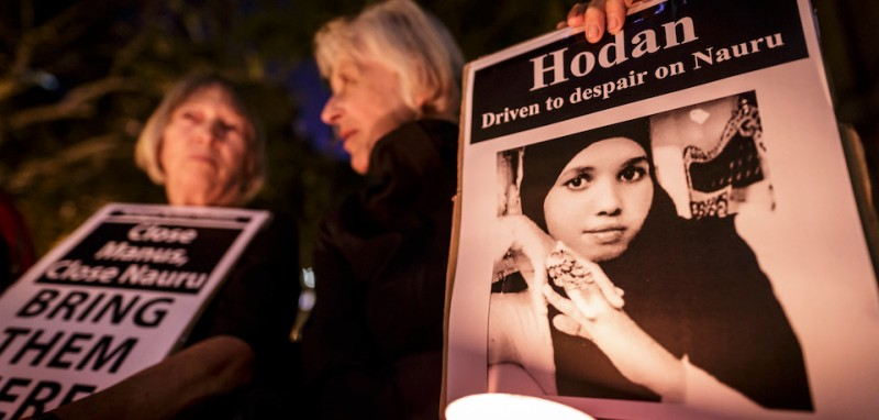 SYDNEY, NEW SOUTH WALES - MAY 04:  Protestors hold a vigil at Sydney Town Hall on May 4, 2016 in Sydney, Australia. Hodan Yasin, a 21-year-old Somali refugee is being treated in a Brisbane hospital after setting herself alight in detention on Nauru on Monday. It is the second attempt on Nauru in a week, after Iranian refugee Omid Masoumali set himself on fire last Wednesday. He later died from his injuries.  (Photo by Brook Mitchell/Getty Images)