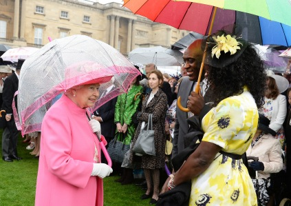 LONDON, ENGLAND - MAY 10: Queen Elizabeth II shelters from the rain under an umbrella as she talks to guests during the first Royal Garden Party of the year in the grounds of Buckingham Palace on May 10, 2016 in London, England. (Photo by John Stillwell - WPA Pool/Getty Images)